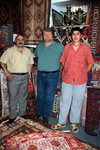 Dmitry in a carpet shop in Baku, with the owner and his assistant Ilchin. The shop is next to the Sultan Restaurant near Maiden Tower