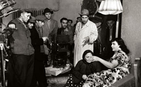 A.Ibrahimov (wearing white raincoat) during the shooting of the film His Great Heart
