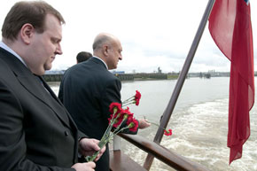 Ambassador Gurbanov consigns some of the 613 carnations to the Thames, each representing a Khojaly victim
