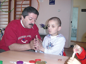 UAFA staff member with child at Shagan home for children with mental and physical disabilities - developing a child's sensory skills