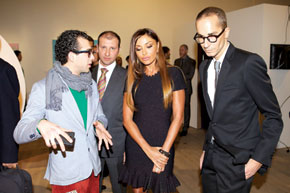 First Lady Mehriban Aliyeva views the exhibits with curator Herve Mikaeloff (right)