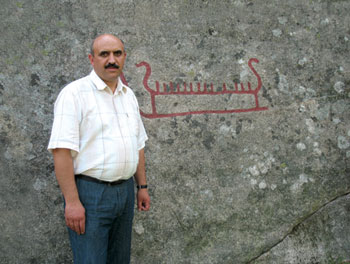 Yusif Mirza with rock carving, Halden, Norway