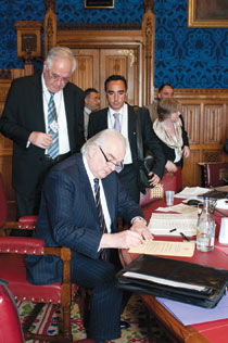 Lord Laird signs the declaration affirming the role of religion in conflict resolution