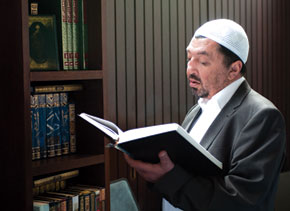 Salman Musayev, Deputy Head of the Muslim Board for the Caucasus, examines literature in the London Central Mosque