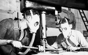 Technicians of Factory 'N' working in gas masks. 1941