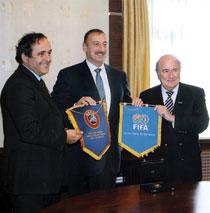 FIFA President Joseph Blatter and UEFa President Michel Platini present pennants to President Ilham Aliyev of Azerbaijan, 2007