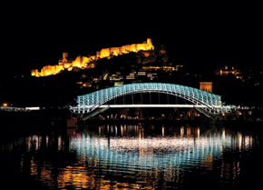 Footbridge over Mikhvera River in Tbilisi with Nar castle in Background
