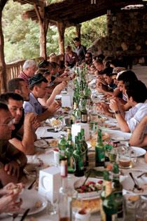 Table Sags Under Georgian Feast on Banks of Mikhavri River VERT