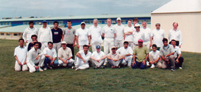 Cricket training - former British Ambassador Andy Tucker is standing in the centre of the back row