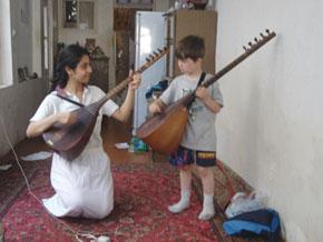 My son learns saz from family friend, Mehseti Jabbarova