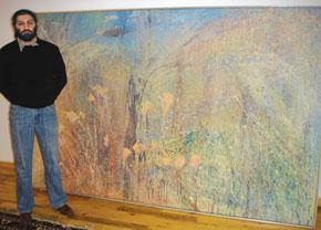 Bahram Khalilov alongside his work