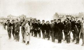 Review of the units of the 11th Army. Members of the Azerbaijan Revolutionary Committee: T. Smilga (third in the first row), second row left to right: G. K .Ordjonikidze, Ch. Ildirim, M. K. Levondovski, S. M. Kirov, F. Shlemova