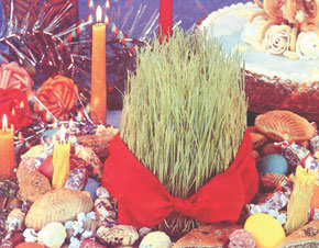 Novruz tray or khoncha with wheat shoots and sweets