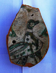 Fragments of clay dishes with colourful decoration