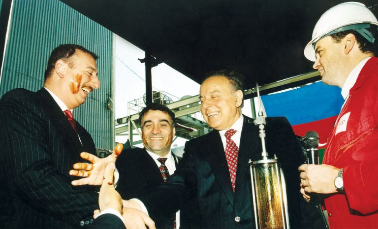 President Heydar Aliyev, Ilham Aliyev (currently the president of Azerbaijan) and Natiq Aliyev, Chairman of SOCAR (currently Minister of Industry and Energy of Azerbaijan), celebrate the first oil production following the signing of the Contract of the Century at a ceremony on 12 November 1997