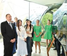 President Ilham Aliyev, First Lady Mehriban Aliyeva and Vice President of the Heydar Aliyev Foundation Leyla Aliyeva admire an exhibit in the Azerbaijan pavilion