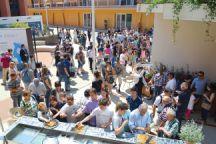 Local Italian visitors enjoy sampling Azerbaijani nuts and dried fruits