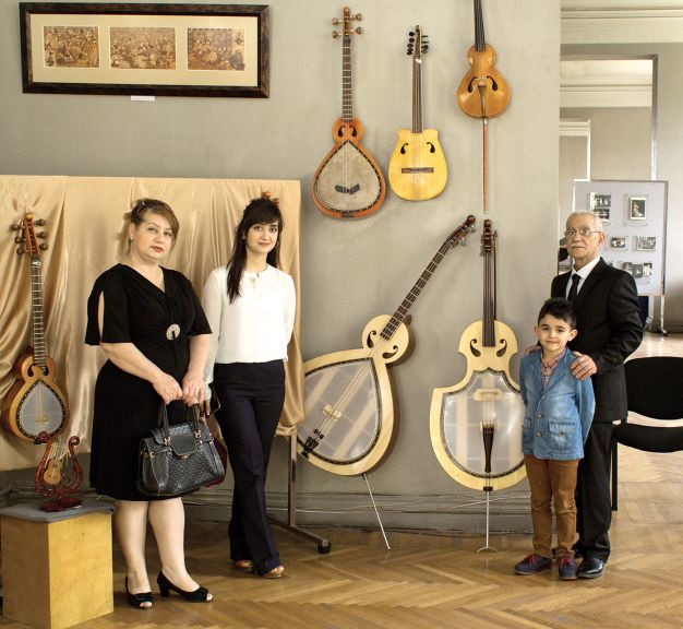 Elshad with family surrounded by his instruments at his summer exhibition in the Museum Centre