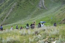 Pilgrims visit a gravesite at the foot of Mount Babadag