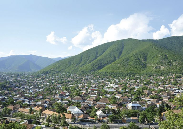 A view over the upper part of the city and surrounding Caucasus Mountains