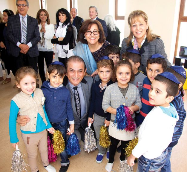 Delegation members with children of the Chabad School Or Avner in Baku. Nov 3, 2015. Seated among the children is Eddia Mirharooni. Behind him are Lili Shafai and Shohreh Soroudi