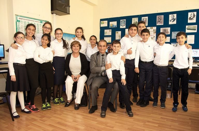 Young students of the Chabad School Or Avner in Baku. Seated among them are Jina Rezvanpour and Eddia Mirharooni