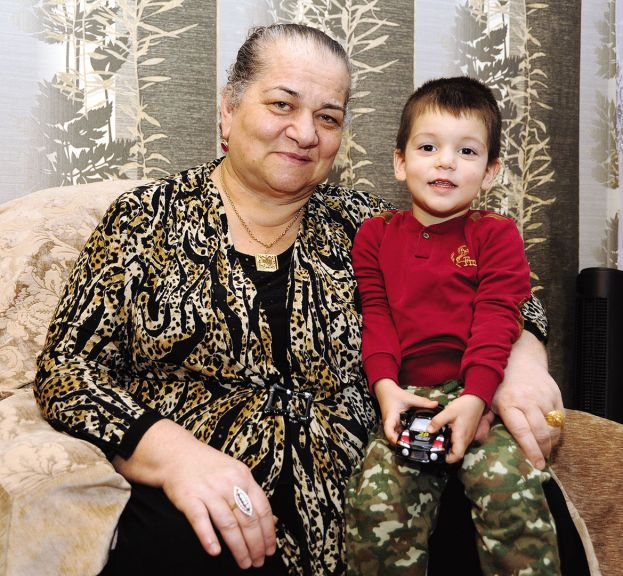 Ilham's mother with his younger son.