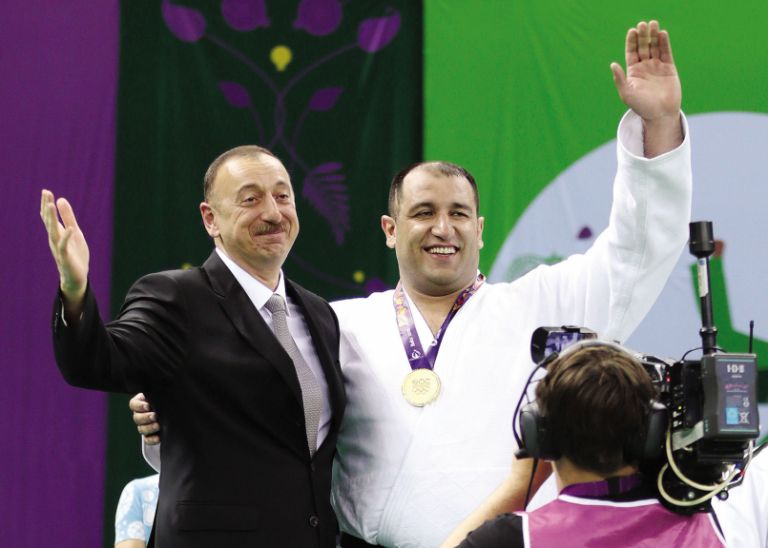 Being presented his European Games gold medal by President Ilham Aliyev