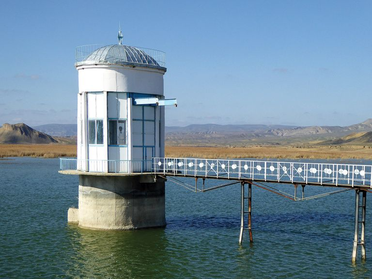 This reservoir lake sits right above the khanegah complex. Climb the dam for attractive views