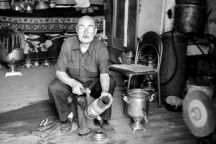 A man repairs a samovar. 2014
