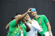 Volunteers take a selfie with zorkhana silver medallist Khayyam Orujov of Azerbaijan, 21 May. Photo: Eldar Farzaliyev