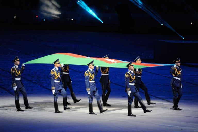 The Games began on 12 May with a glamorous opening ceremony.  Here the Azerbaijani flag is paraded around the stadium. Photo: Eldar Farzaliyev