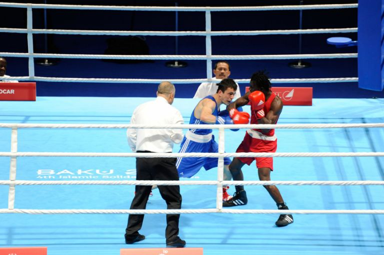 Turkey's Hakan Dogan (blue) defeats Joel Williamson (red) of Guyana in the men's lightweight boxing on 12 May. Photo: Eldar Farzaliyev