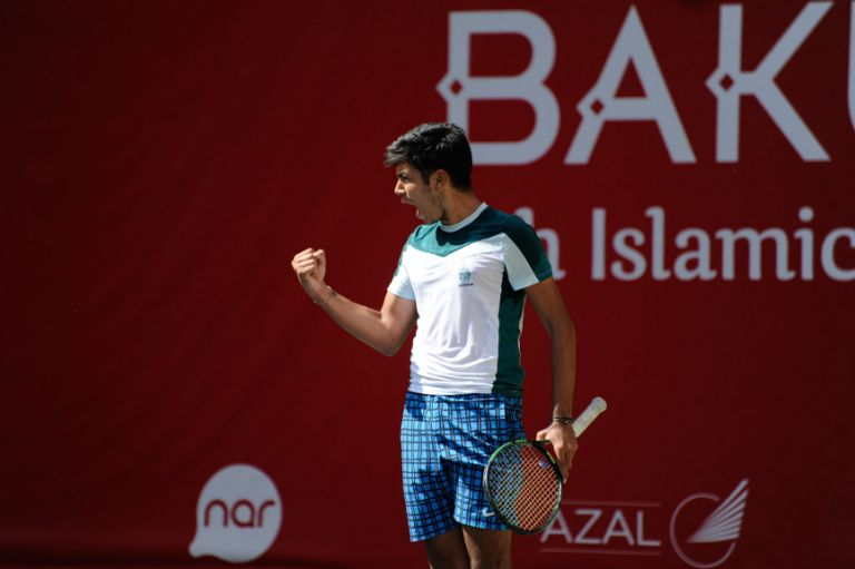 Azerbaijani tennis player 17-year-old Rasul Gojayev celebrates a point in the men's doubles on 13 May. Photo: Eldar Farzaliyev