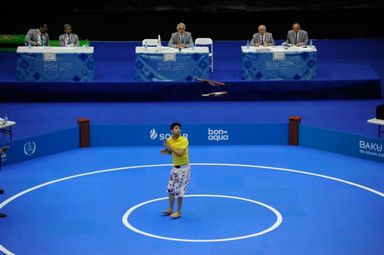 Pezhman Sokoonati competes for Iran in the zorkhana meel bazi final on 21 May. Photo: Eldar Farzaliyev