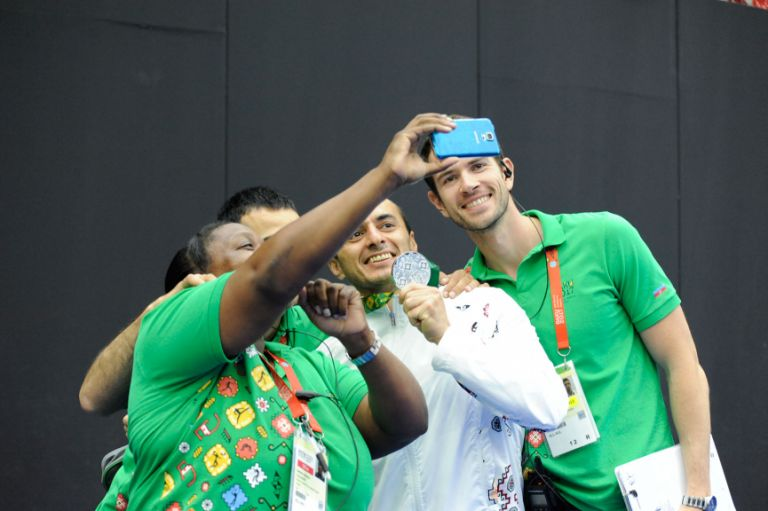 Volunteers take a selfie with zorkhana silver medallist Khayyam Orujov of Azerbaijan, 21 May. Photo: Eldar Farzaliyev