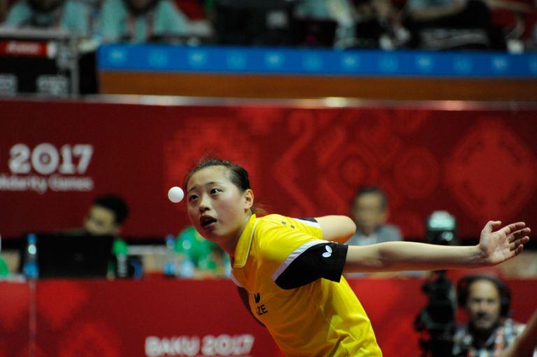 Azerbaijan's Xingtai Chen keeps her eye on the ball during the women's team table tennis, 22 May. Photo: Eldar Farzaliyev