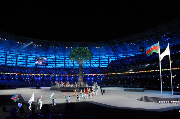 """The Games finished on 22 May with a closing ceremony focusing on Azerbaijani heritage and the character of the host city. Here, flag-bearers walk past the """"tree of life."""" Photo: Eldar Farzaliyev"""