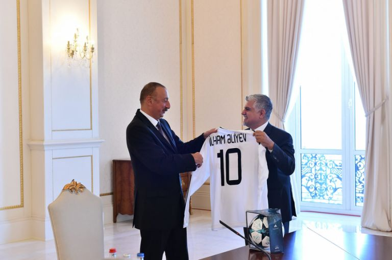 Qarabag FC's club president Tahir Gozel gifts a personalised shirt to the Azerbaijani president Ilham Aliyev on 24 August, the day after the club made history. Photo: Azertaj