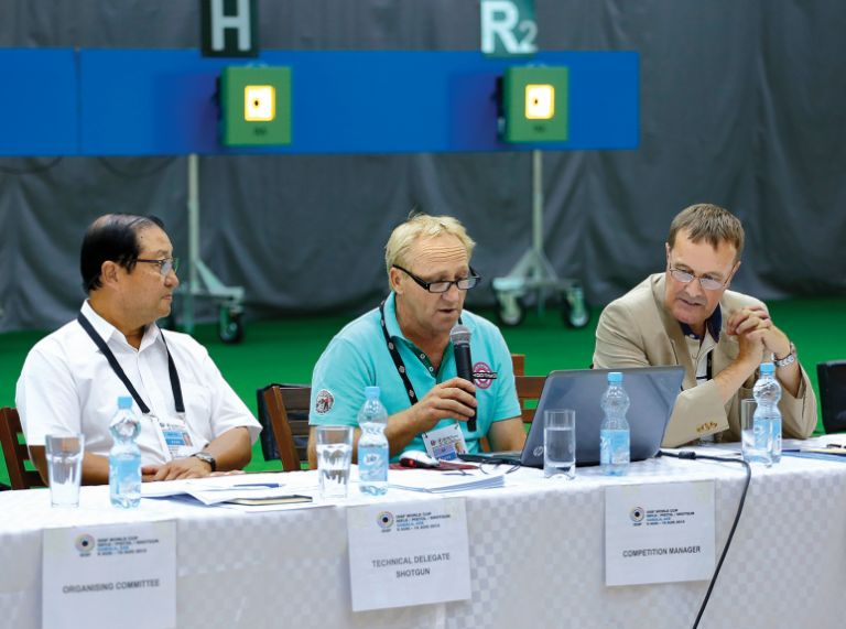 Left to right: Bhattakarka Bunnag (Thailand), ISSF Technical Delegate for Shotgun, Wilhelm Xaver Grill (Germany), OC Competition Manager and Peter Underhill (UK), ISSF Technical Delegate for Rifle/Pistol