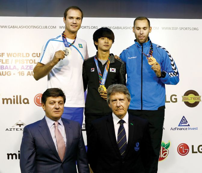 Top (left to right): Men's 10m air pistol medallists Vladimir Issachenko, Kazakhstan (Silver), Cheongyong Kim, South Korea (gold) and Juraj Tuzinsky, Slovakia (bronze) Bottom (left to right): Sabuhi Abdullayev, Mayor of Qabala and Stewart Watterson, Chairman of the ISSF Classification Jury