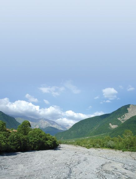 A view of the Kish River and the Greater Caucasus Mountains