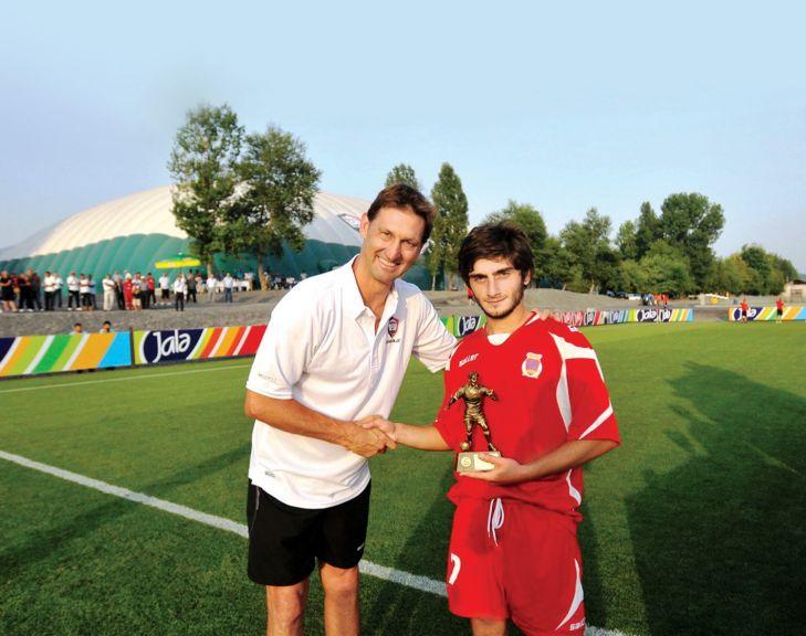 Presenting a trophy to David Razanashvili, the best player at the 2011 1st Jala International Football Tournament in Qabala