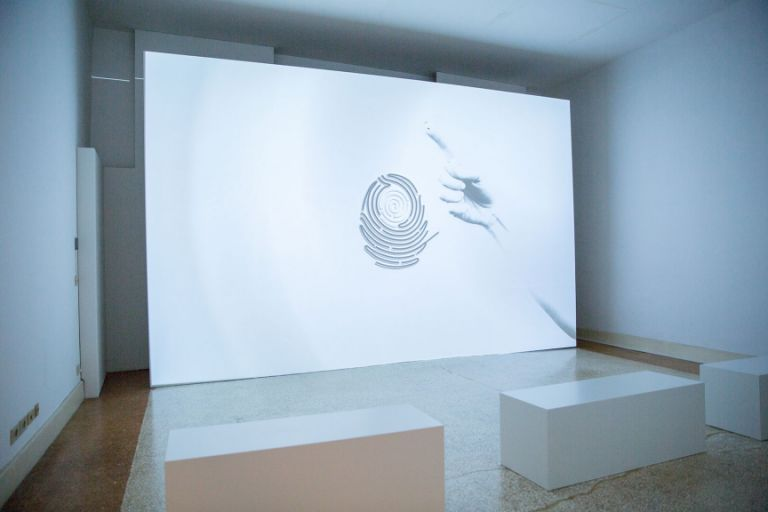 Profile by HYPNOTICA invites visitors into a medidative experience as they observe fingerprints change on the screen, embodying the cycle of life. Photo: Javid Guliyev